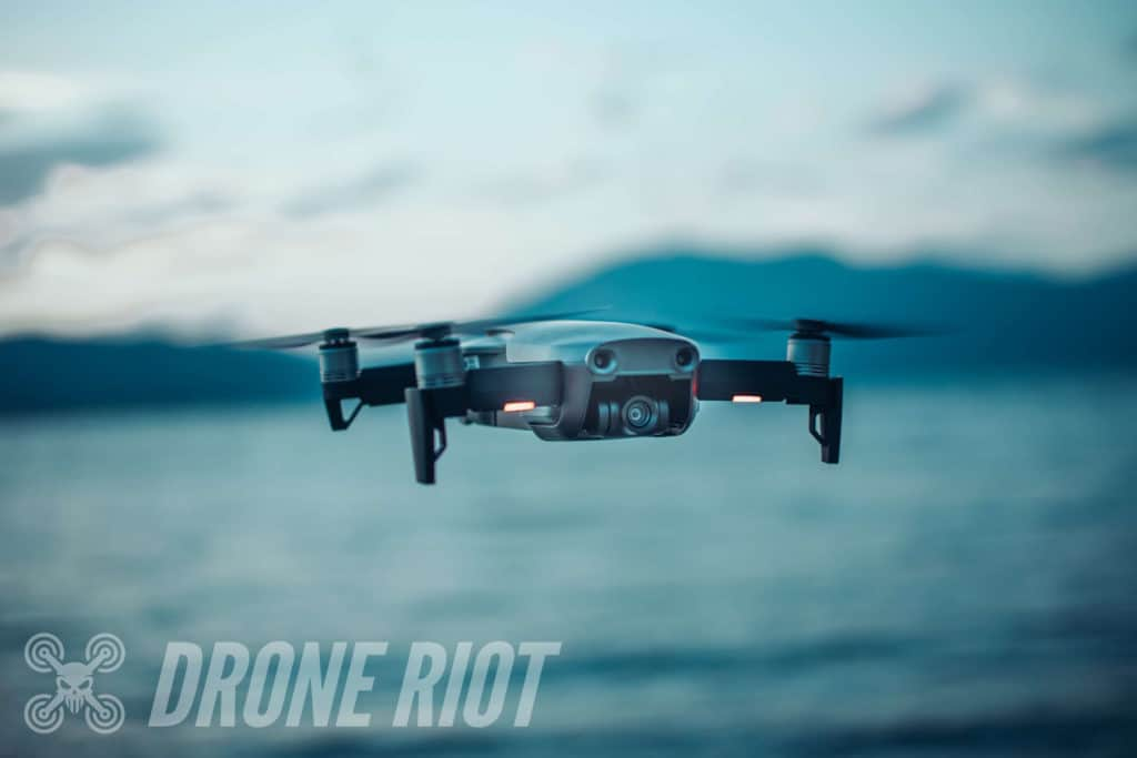 Drone flying past lake