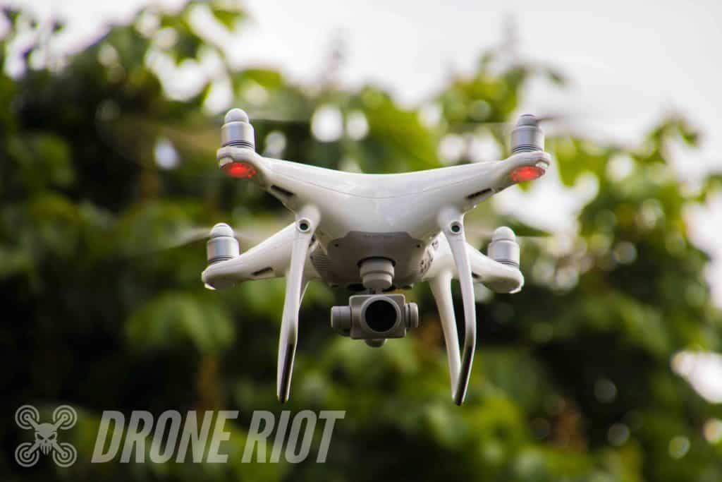 White drone flying